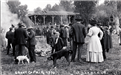 Black and white photo of people at 1910 County Fair